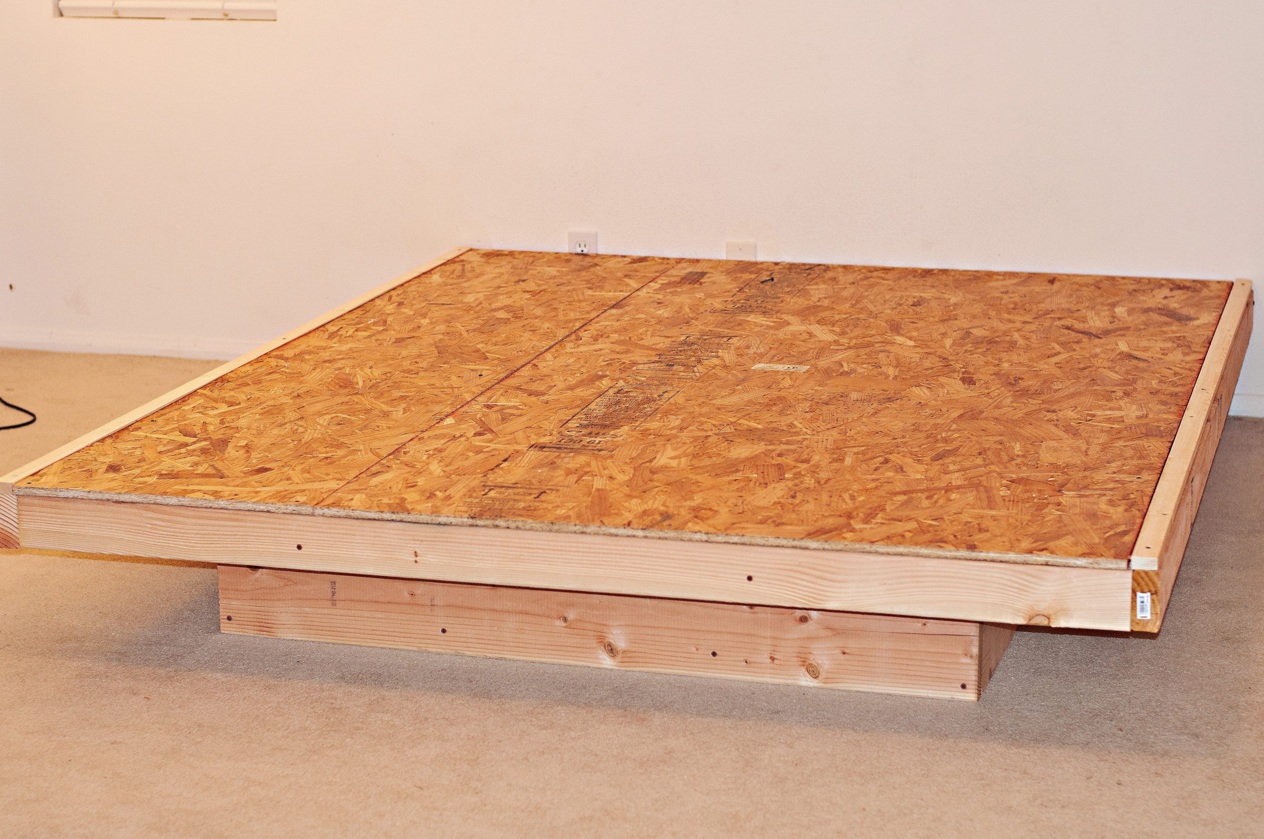 Time for the Oriented Strand board 4ft x8ft, I had one cut by home ...